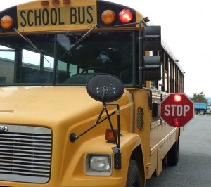 All vehicles must stop when a bus displays stop arms and flashing lights.