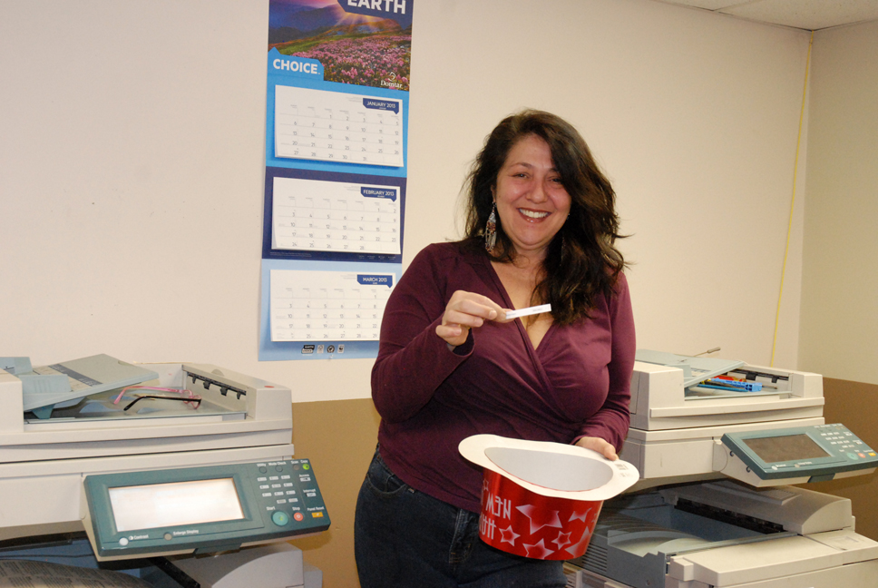 Linda Steele, of SOS Printing, draws the winner for the third HCPress.com birthday giveaway. Photo by Ken Ketchie