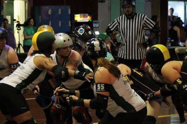 Rogue Rollergirls blocking Appalachian Rollergirls at the jam line Courtesy Kevin Gordon, ARG photographer