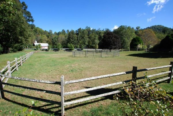 A view from the pastures behind the round house show the nearby church building, which sits by the river along pastures on the opposite side of Shulls Mill Road.